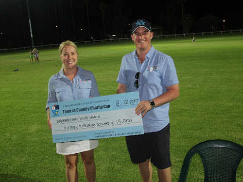 Narrabri Youth Shack's Anna Dugdale is handed the cheque for $15,000 by Narrabri District Cricket Association president Brendon Ward at the completion of the Charity Cup Town v Country match on Friday, December 8.