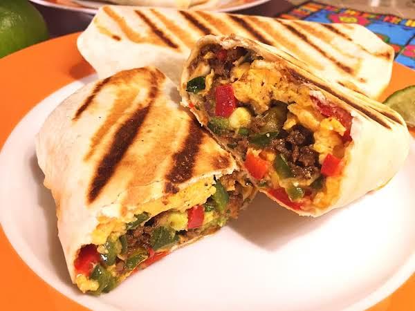 Burritos On An Orange Plate.