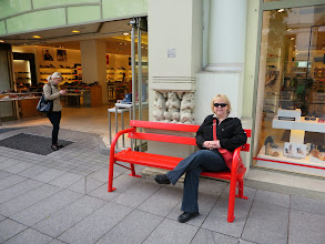 Photo: Laurie on an interesting bench with three bears eating toast