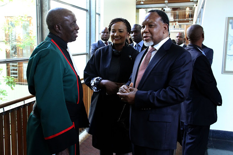 Deputy Judge President Dikgang Moseneke (L) welcomes former President Kgalema Motlanthe (R) and his wife Dudu Mtshali to the justice's farewell at the Constitutional Court on Friday. Picture: GCIS