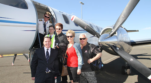 Fly Corporate Sales manager Geoff Woodham, front left, was on hand to welcome the first passengers, Pam Foster, Lyn Large and Tony Large,  aboard the new Narrabri to Sydney air service yesterday morning, pictured with captain Peter Saunders and first officer Keiran Pilgrim.