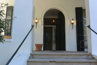 Photo: The front door; as I recall this vestibule opens into the front rooms at left and right: it is not just ornamental, but in this town, I am told,  it is unique.