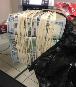 Bundles of dollars found in the hand luggage of a student who boarded a flight to Hong Kong at OR Tambo International Airport on September 11 2018.