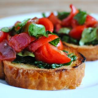 Tomato Bruschetta with Sauteed Spinach.
