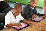 Mathonsi Msizi and Thandiswe Shabane, Grade 1 pupils  from  St Christophers Primary in Kwadukuza, KwaZulu-Natal,   use  tablets for better learning  outcome.