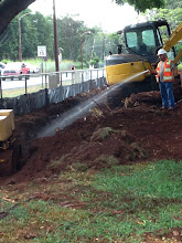 Photo: Continuing with the backfilling and compacting.