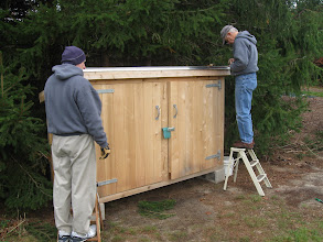 Photo: New storage shed receives roof shingles. Thank you Bill, Bob, and Ed (not shown).