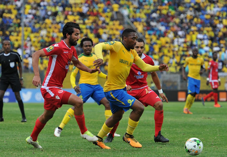 Sibusiso Vilakazi of Mamelodi Sundowns challenged by Salaheddine Saidi of Wydad Athletic during 2017 Caf Champions League game between Mamelodi Sundowns and Wydad AC at Lucas Moripe Stadium on 17 September 2017.