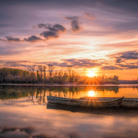 boats in autumn sunset  by Cornelius D - Transportation Boats
