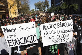 """Photo: Students march during a demonstration against the Spanish government's new education policy and alleged corruption cases, on the second day of a three-day long nationwide strike in public secondary education, in Valencia February 6, 2013. The placards read, """"Less corruption, more education (L)"""" and """"Rajoy, Barcenas, did you leave some envelopes for education?""""   REUTERS/Heino Kalis (SPAIN - Tags: POLITICS CIVIL UNREST EDUCATION)"""