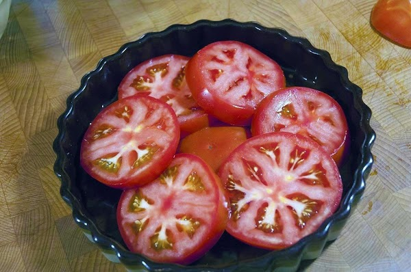Add the tomatoes to an ovenproof dish, and allow them to overlap slightly.