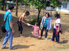 Photo: Baan Nong Kiao: father and daughter with healthcare workers from Chiang Dao.