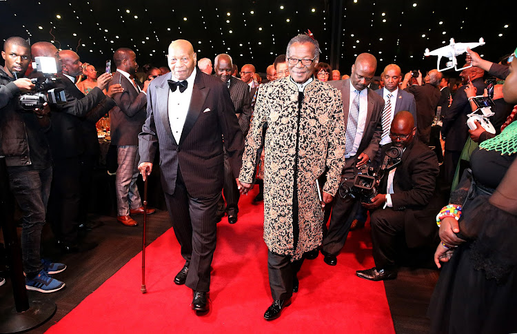 Prince Mangosuthu Buthelezi (right) in his black and gold suit at the start of his birthday celebrations.