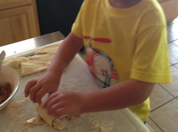 Roll each bun up starting with wide end. Place on a cookie sheet that...
