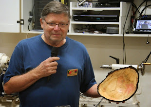 Photo: Richard Webster talks about his natural-edge bowl from a neighbor's dogwood tree that must have been huge.  It's unusual to have red color in dogwood.