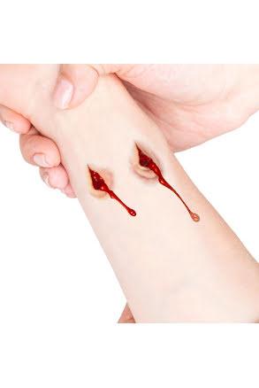 Tatuering sår, dubbla droppande sår