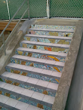 Photo: Sixth full day of work (November 1, 2013): installation of the tread tiles on top of each of the Hidden Garden Steps (16th Avenue, between Kirkham and Lawton streets in San Francisco's Inner Sunset District) and landings continues as installation of the 148-step ceramic-tile mosaic designed and created by project artists Aileen Barr and Colette Crutcher is nearly 2/3 complete. For more information about this volunteer-driven community-based project supported by the San Francisco Parks Alliance, the San Francisco Department of Public Works Street Parks Program, and hundreds of individual donors, please visit our website at http://hiddengardensteps.org.