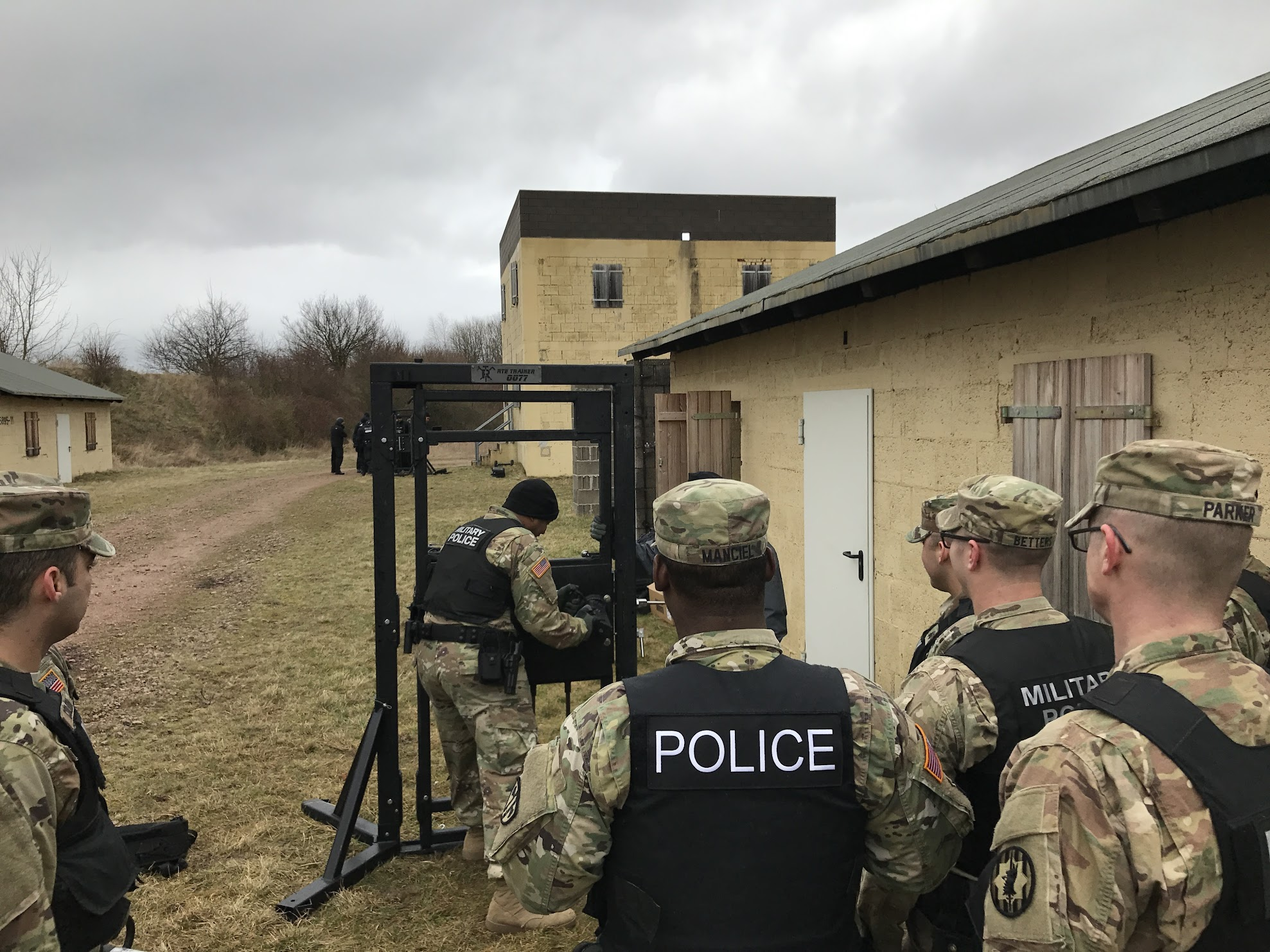Andy Ruhland evaluates breaching technique conducted by one of the US Army Military Police Soldiers.