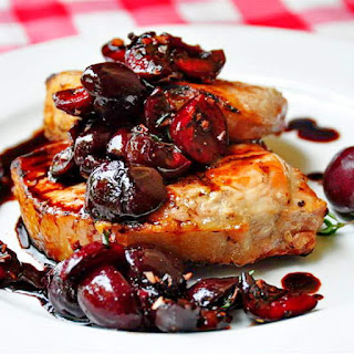 Grilled Pork Loin Chops with Balsamic Thyme Cherries.