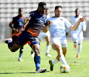 Moeketsi Sekola of the Real Kings and Tauriq Dien of Cape Umoya United FC during the GladAfrica Championship match between Cape Umoya United and Real Kings at Athlone Stadium on December 20, 2019 in Cape Town.