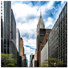 Photo: This image was created from a grab shot that I took looking up 42nd Street in New York as I crossed from one side to the other. The image is a square crop of a wide shot, but had I been thinking, I would have shot this as a vertical. However, like I said, it was a grab shot.  Processing consisted of some initial work in Lightroom 4 and then loading into Photoshop to do some additional work including some perspective correction. I also used a combination of Color Efex Pro 4 and Topaz Simplify to finish off the image. Finally, in an effort to thwart the ugly black borders used on Google+ I added a bit of a white border just to create some separation. :-)