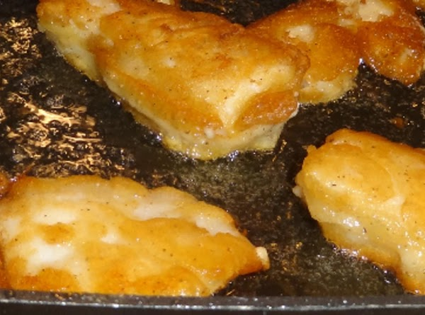 Drop the coated fish in the hot oil.  Fry about 6 to 8...