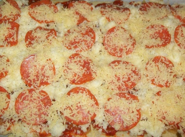 Sprinkle with the Parmesan Romano cheese. As much or as little as you like.