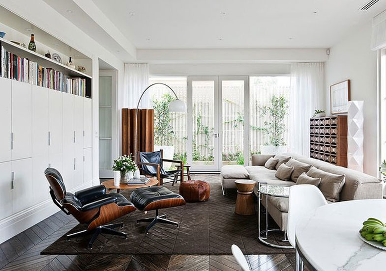 eames lounge chair and ottoman in a living room