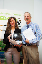Photo: Closing Ceremony:  Winner of the 1st door prize ( a free ticket to WODCON XXI), Dr. Craig Vogt, Craig Vogt Inc, Environmental Consulting, USA (right), and Aneta Trajkovska, Congrex, Belgium to thank for the lucky hand