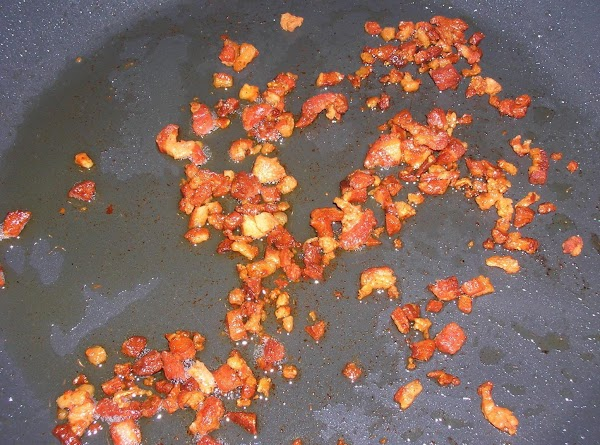 Meanwhile, cook the pancetta in a large skillet until crunchy. Reserve about 1 tablespoon...
