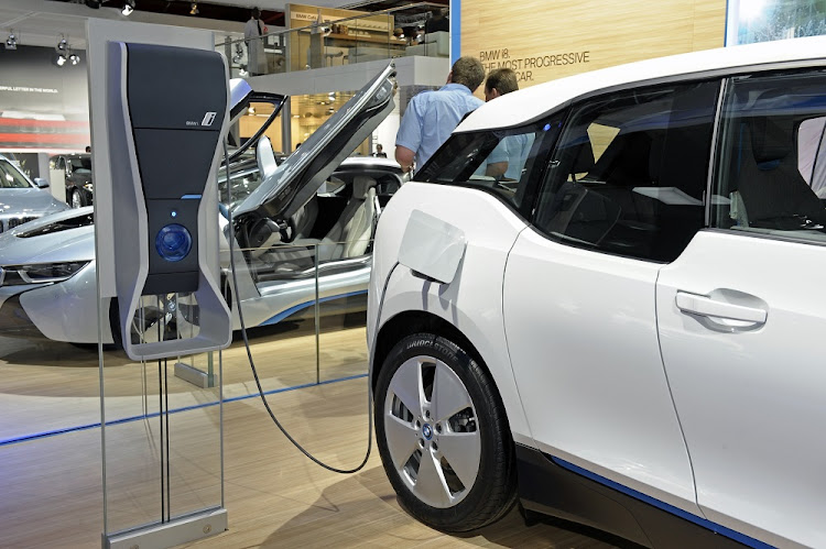 New on the block: A BMW electric-car charger on display at the International Car Show at Nasrec, Johannesburg, in 2013. Five years later there are fewer than 500 electric vehicles on SA's roads. Picture: RUSSELL ROBERTS/FINANCIAL MAIL
