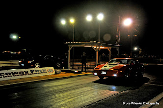 Photo: James Hetfield in the far lane, in the black Charger, and Ron Capps in the orange Pontiac, the first of two rounds.