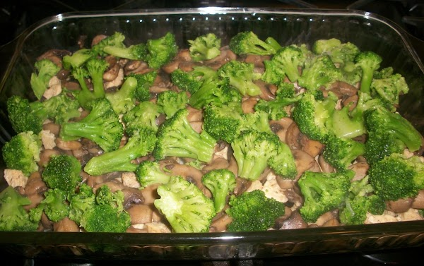 Layer frozen broccoli florets on top of the sauteed mushrooms.   NOTE: You can cook...