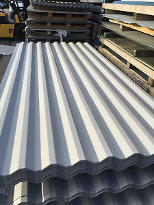 Metal roof panels corrugated in a stack