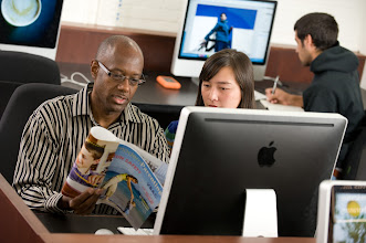 Photo: Terence Oliver and students in Carroll Hall Mac lab (Photo by Steve Exum)
