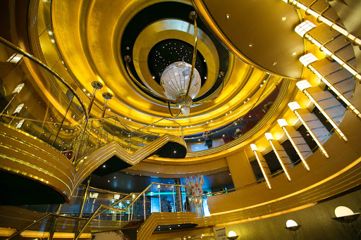 oosterdam-atrium2.jpg - A Waterford crystal globe highlights the gold gilt opulence of the three-deck atrium on ms Oosterdam.