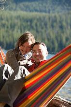 Photo: Young couple sitting in hammock on Jackson Lake. Grand Teton NP, WY