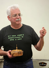 Photo: On his left hand, Jeff sports a ring he turned with a textured band.  In his right is a lidded vessel made from three different woods.