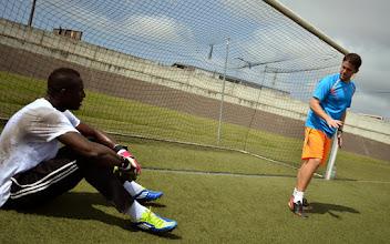 Photo: Coach McKinstry working with goalkeeper John Trye [Training camp ahead of Leone Stars v Ivory Coast on 6 September 2014 (Pic © Darren McKinstry / www.johnnymckinstry.com)]