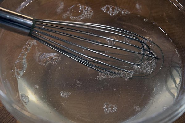 Whisk the honey and warm water together in a bowl.
