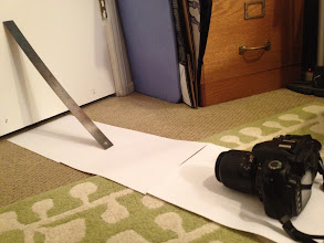"""Photo: Setup: I placed the camera approximately 2 ft from the wall (door). The 18"""" ruler is propped up against the wall at an exact 45-degree angle (with 18in as the length of hypotenuse, I backwards calculated (via Pythagorean theorem) the lengths of the triangle sides to be 12.7in). The camera lens sits 31 cm from the end of the ruler, so U = 310mm."""