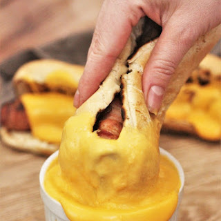 Bacon Wrapped Bratwursts with Beer Cheese Sauce.
