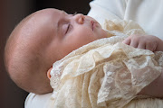 Prince Louis, son of Prince William and Kate Middleton, in a replica of the Honiton gown at his christening on July 9 2018 in London, England.