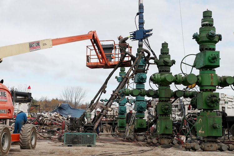 A worker cleans and lubricates the head of the machine after the hydraulic fracturing of a gas field segment at Southwestern Energy's natural gas production site at the Marcellus Shale formation in Camptown, Pennsylvania, US. Picture: BLOOMBERG/JULIA SCHMALZ