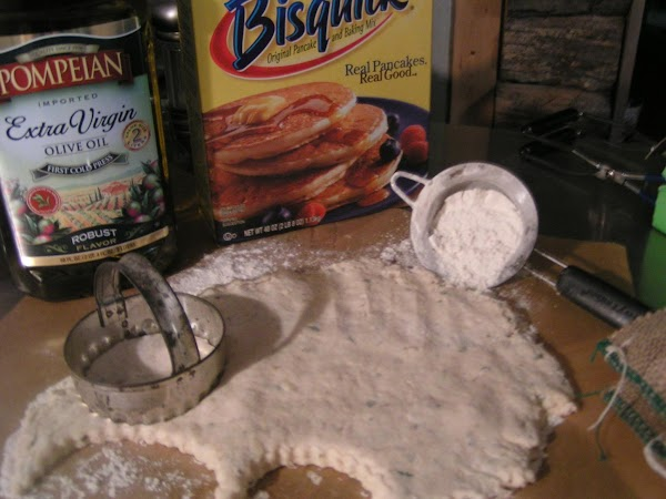 On a lightly floured surface, pat dough out and cut with biscuit cutter.