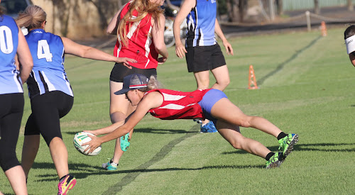 Brooke Field dives over for one of the Redbacks' 11 tries against BPR yesterday afternoon in round seven of the Narrabri Touch ladies competition. Behind (number seven) is teammate Lauren Nott who set up the try.