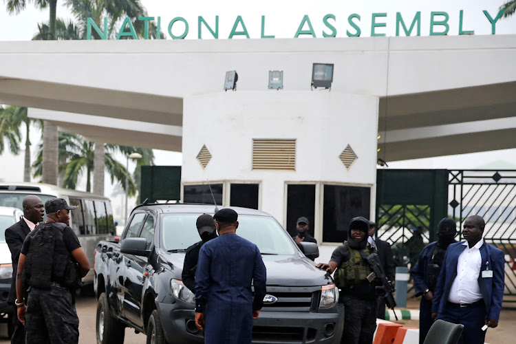 Members of security forces block the entrance of the National Assembly in Abuja, Nigeria on August 7 2018.