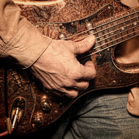 Hard Rock by Kim Wilson - People Musicians & Entertainers ( studio, music, interior, musical, indoor, body part, electric, male, rock, instrument, hands, horizontal, inside, musician, guitar, man, object )