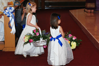 Photo: The girls bring flowers a symbol of the fragrance of lives consecrated to God