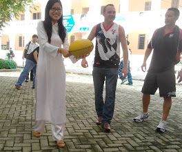 Photo: Aussie Rules can even be played in the traditional Vietnamese dress, the Ao Dai. Shannon and Hewy watch on.